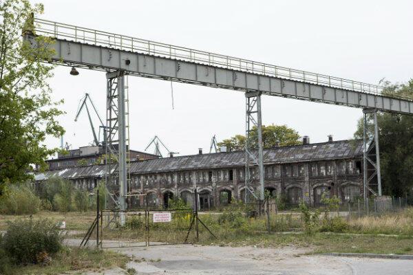 Eksperci ICOMOS zalecają zachowanie stoczniowych obiektów i wpisanie ich w nową tkankę miasta.