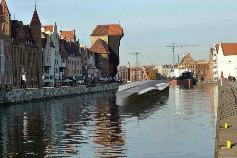 Gdy kładka jest ustawiona wzdłuż nurtu Motławy, jej konstrukcja przypomina kształtem łódż podwodną.