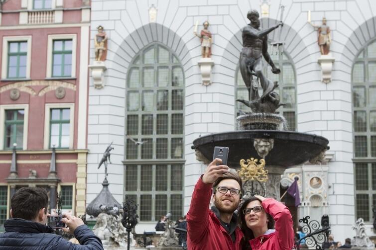 Zdjęcie pod Neptunem - obowiązkowy punkt programu dla każdego turysty odwiedzającego Gdańsk