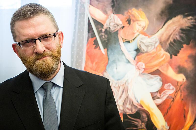 Grzegorz Braun i Archanioł Michał zabijający Szatana