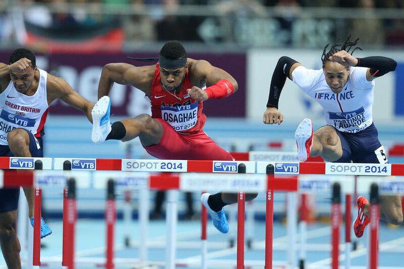 Halowe Mistrzostwa Świata w lekkoatletyce, 9 marca 2014 roku. Final biegu 60 m przez płotki mężczyzn, w środku zwycięzca Omo Osaghae (USA)