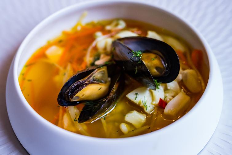 Amber soup with calamari and saffron
